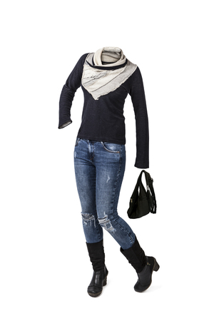 Empty clothes. Woman in casual clothes. White and black sweater, worn jeans, high heel boots and black purse.