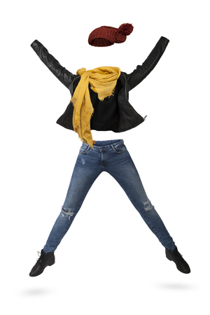 Empty clothes. Woman jumping wearing a black leather jacket, yellow scarf, jeans and red wool cap.