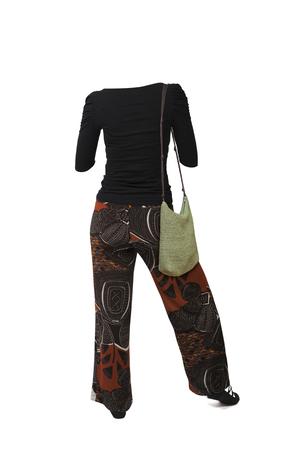 Empty clothes. Woman backwards wearing ethnic pants, black shirt and green bag. Imagens