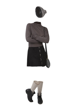 Empty clothes. Woman wearing schoolgirl clothes. Wool cap, striped shirt, black skirt and shoes with high socks. Imagens