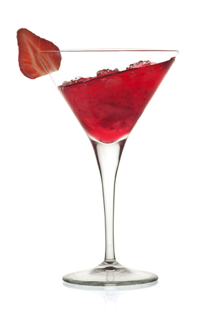 Red alcoholic cocktail with leaning liquid and a strawberry
