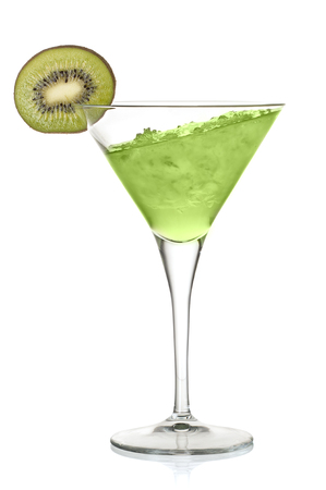 Green alcoholic cocktail with leaning liquid and a kiwi Imagens