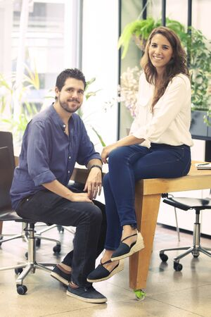 Portrait of the co-founders of a successful startup business company posing in their office enviorment.