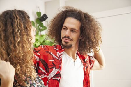 Attractive african american man dancing salsa with his fiancee. Imagens