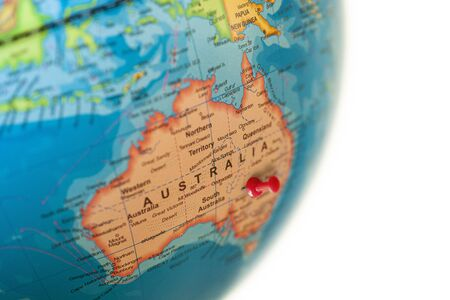 Australia map. Earth globe close up with a red pin in Australia. Imagens