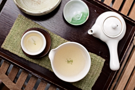 traditional culture: Green and white Korean tea set in a traditional teahouse Stock Photo