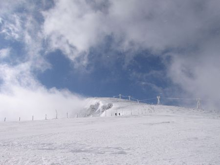 mountin: cloudy mountin, winter in mountins, snow and clouds, up the mountin, old skiing track, holside in cloud, hilside Stock Photo