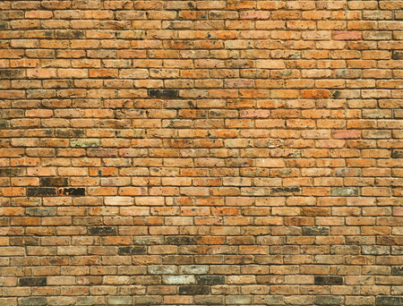Detailed old yellow brick wall background photo texture