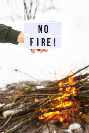The concept of nature protection, protection from forest fires, ecology. Open fire warning. 版權商用圖片
