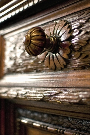 Old-fashioned furniture - chests of drawers handle photo