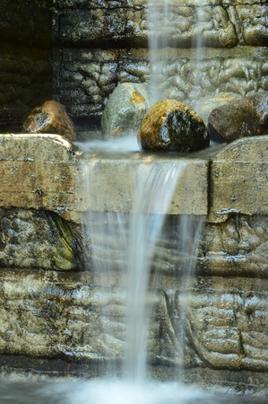 water feature: A small water feature flowing. Stock Photo