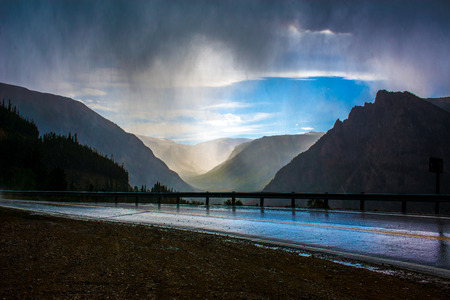 rushes: A cold rainstorm rushes through the mountains. Stock Photo