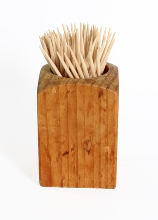 toothpick: Wooden toothpick container against a white background.
