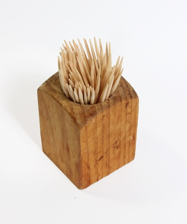 toothpick: Wooden toothpick holder against a white background.