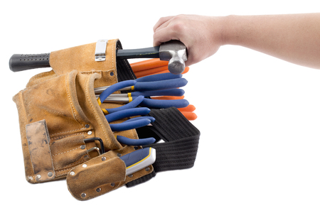 wor: person taking out hammer Stock Photo