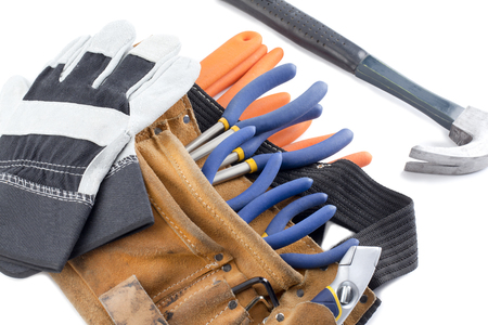 macr: close up shot of tool belt with wrench and hand gloves