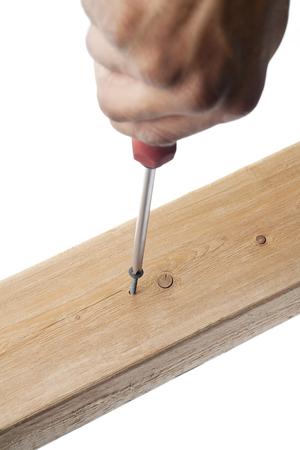 screw being driven into wood Banco de Imagens