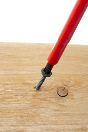 odd jobs: screwdriver on woodscrew Stock Photo