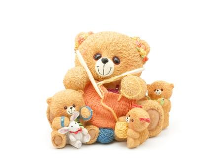 Knitting teddy bear family. Clay figurine isolated on white