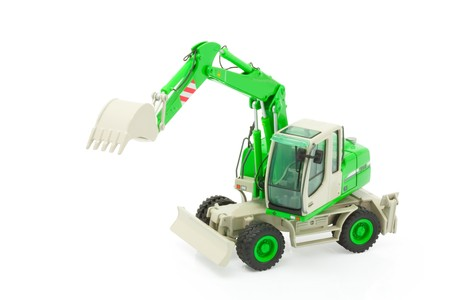 bulldoze: Green excavator isolated on a white background. path included Stock Photo