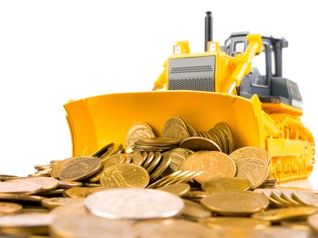 Yellow bulldozer raked pile of coins over white background
