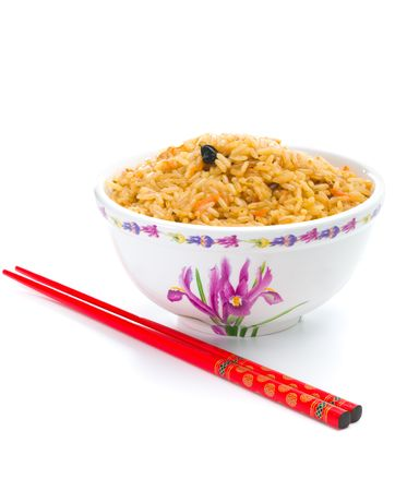 Bowl of cooked rice with chopsticks over white background