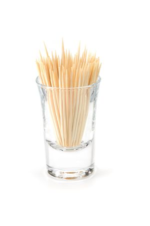 Glass of toothpicks over white background 版權商用圖片