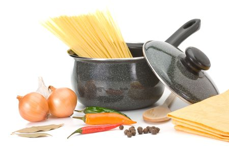 Saucepan with ingredients for chicken soup over white background