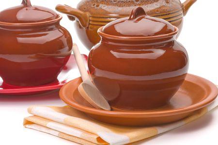 Three ceramic pans over white background