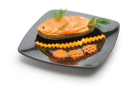 Dish with a sandwich of carrots and cheese on a white background