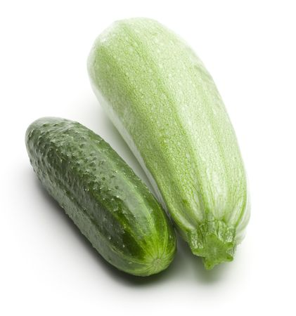 Raw ripe cucumber and squash on a white background
