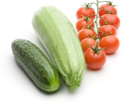 Raw ripe cucumber, squash and tomatos on a white background 版權商用圖片