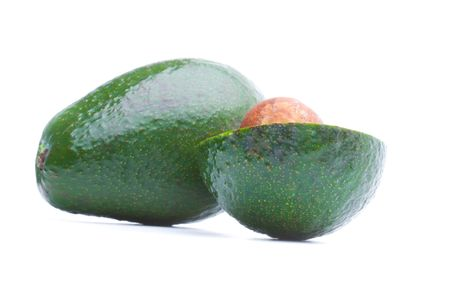 Whole and half avocados isolated on white background