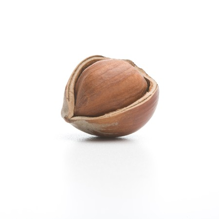 Cracked hazelnut isolated on a white background 版權商用圖片