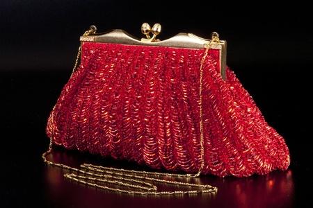 Red evening bag over black background 版權商用圖片 - 8695207
