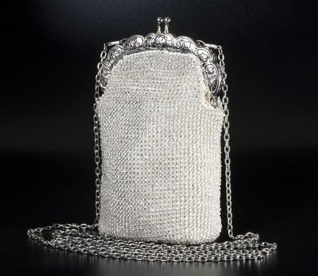 Beaded evening bag over black background
