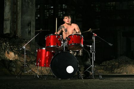 The image of the musician playing on drums photo