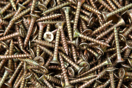 The background consisting of metal chromeplated screws Stock Photo