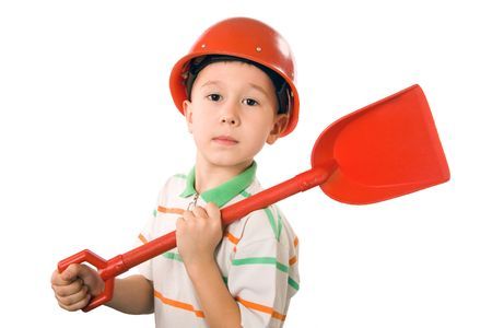 The boy in a helmet and with a shovel on a white background photo