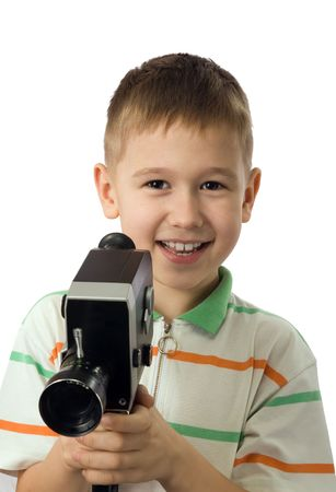 youngs: The smiling boy with retro a movie camera Stock Photo