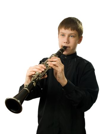 clarinet: The teenager playing on a clarnet. It is isolated on a white background.