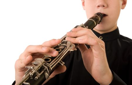 Clarinet player. It is isolated on a white background. photo