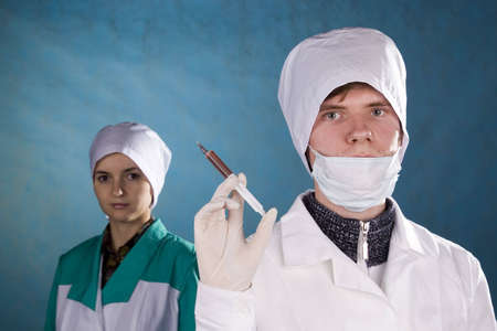 The medical worker with a syringe in a hand. Stock Photo - 2793411