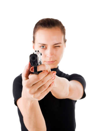 Girl with gun. It is isolated on a white background. photo