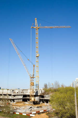 Cranes working on a building site in city Stock Photo - 2925802