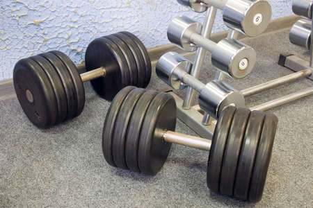 Dumbbells on a rack in a gym. photo