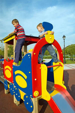 The boys climb on the equipment of a playground Stock Photo - 3575071