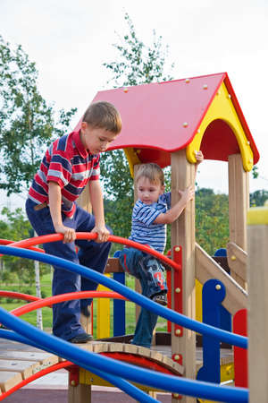 The boys climb on the equipment of a playground Stock Photo - 3575068