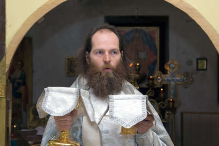 cassock: The Russian orthodox priest in a temple