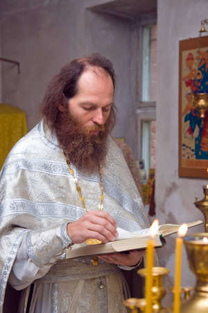 priesthood: The Russian orthodox priest in a temple